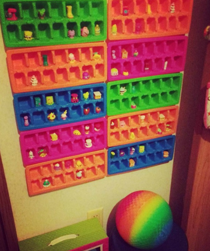 Ice Cube Tray Shopkins Organizer - If your kids are into the Shopkins craze (or you have other tiny toys or figurines to keep on display and organized), mount a few ice cube trays to the wall
