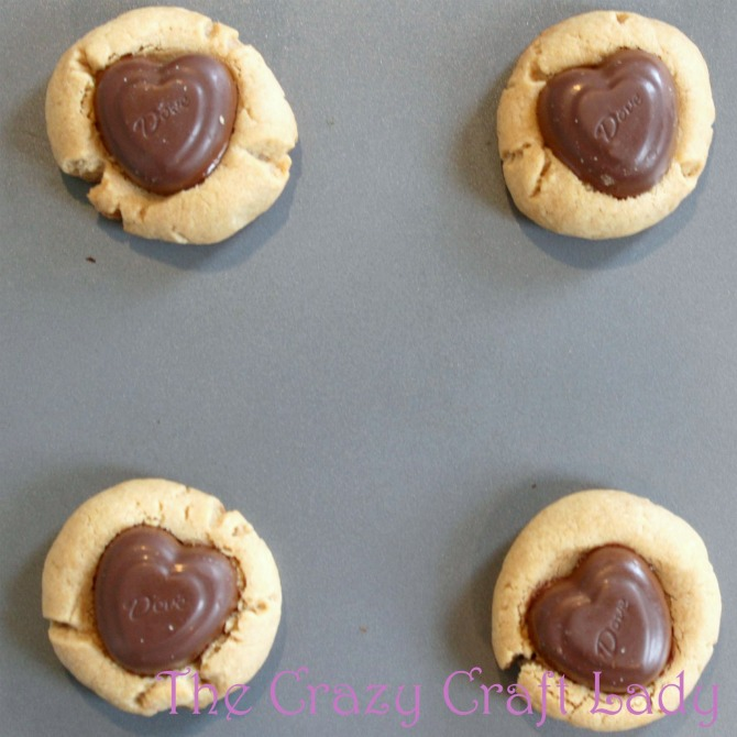 Make these Peanut Butter Chocolate Thumbprint Cookies with a simple peanut butter cookie dough and seasonal chocolates. This is the perfect Valentine's Day or Christmas cookie recipe!