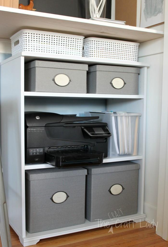 A booksheld under a bar-height desk creates plenty of storage