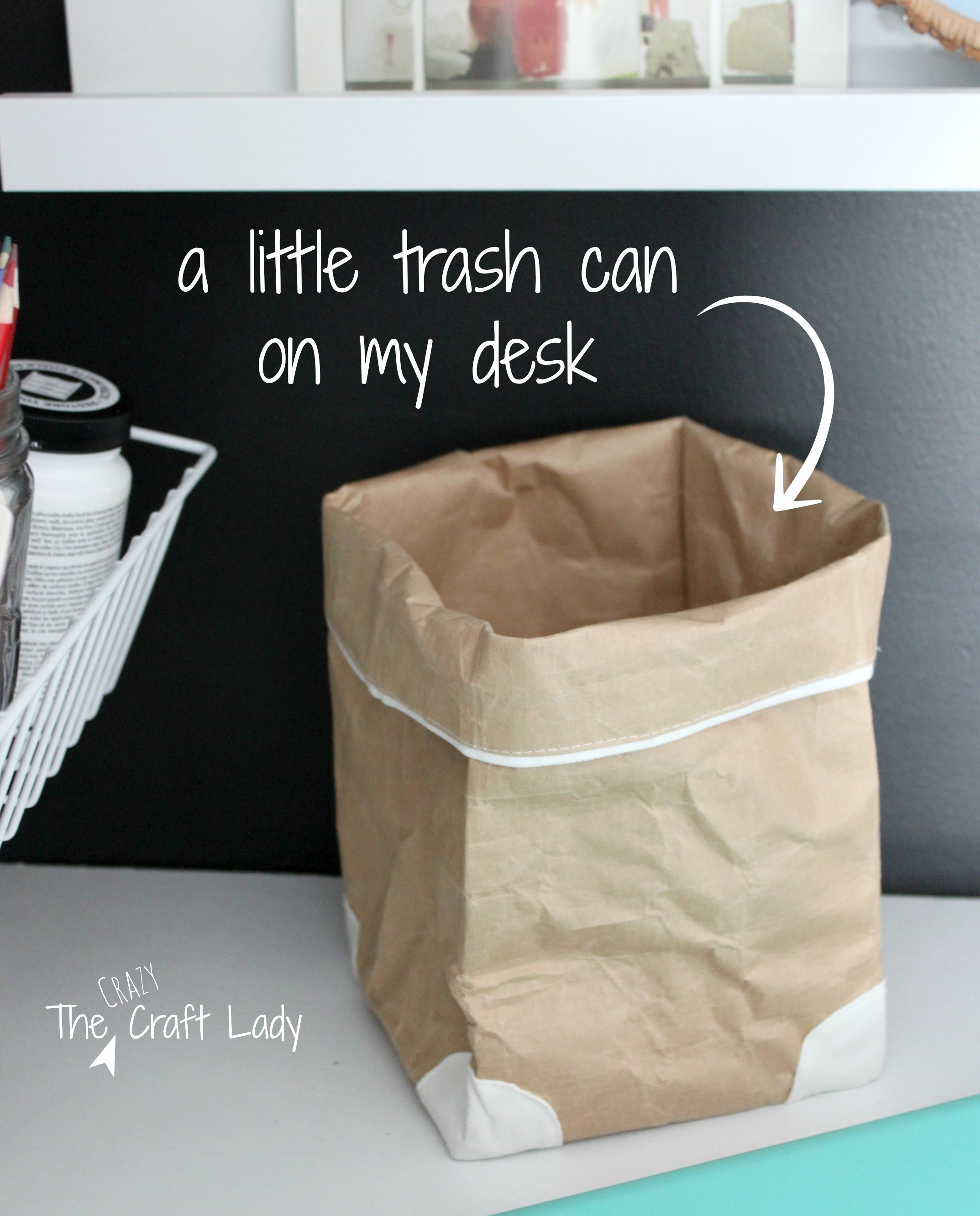A Little Brown Paper Bag Serves As Trash Can On Desktop Or Work E For Small Ss