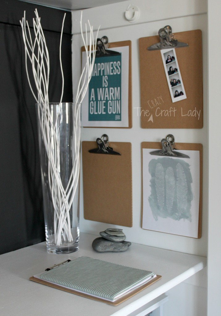 Mount four clipboards on the wall next to your desk and display free printables or pictures - you can rotate out your display as often as you want