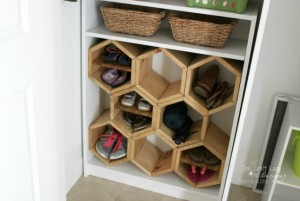 I LOVE these hexagon shoe cubbies! She took an old bookcase and transformed it into a unique shoe shelf to keep her family's entry organized.