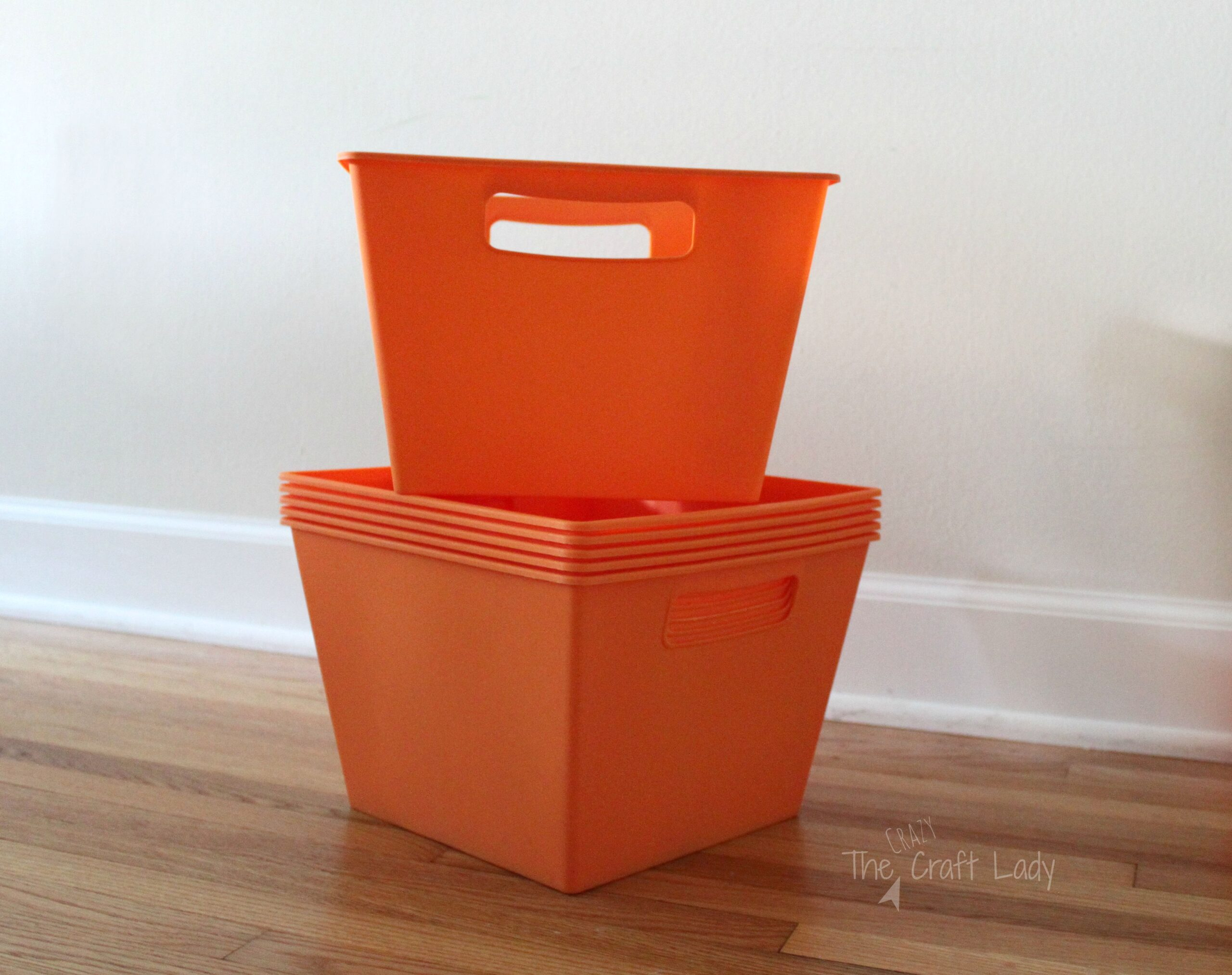 Getting organized with painted dollar store bins the for Painting plastic bins
