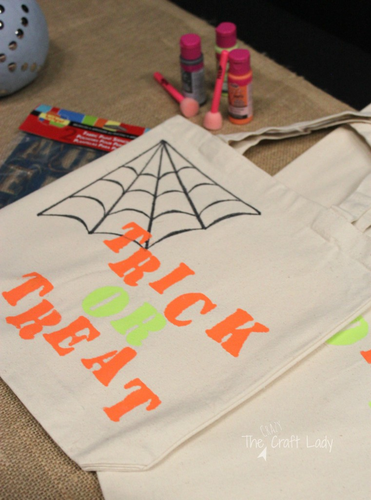 Stencil + paint on canvas bags for trick-or-treating.