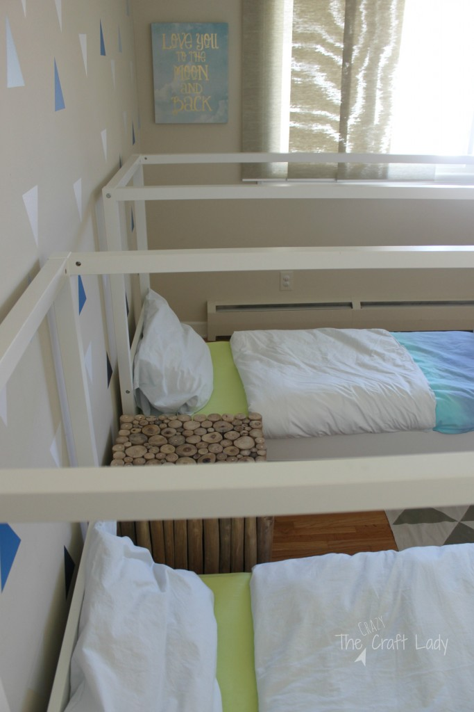 A coastal cool twin bedroom filled with tons of DIY project inspiration