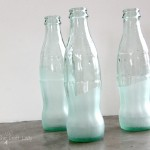 Sea Glass Painted Bottles - a super simple and cute DIY upcycle craft project using #MarthaStewartCrafts Frost Effect Paint.