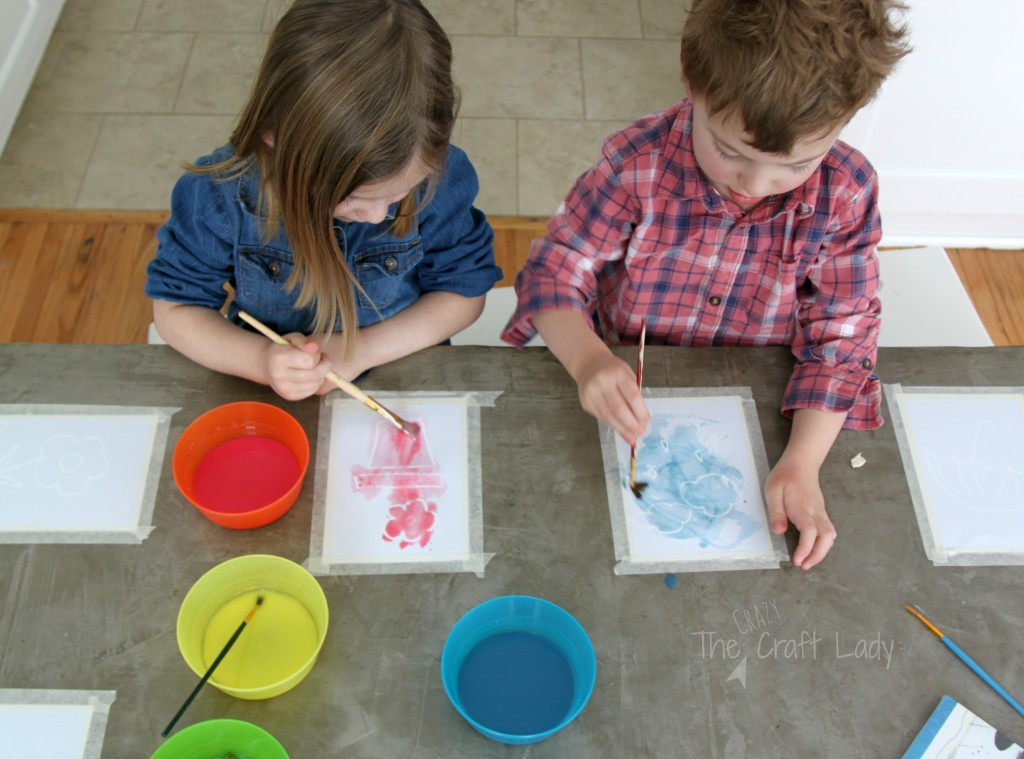 "Easy Spring Watercolor Craft - this watercolor project with ""magic pictures"" that appear when you paint, is an AWESOME Spring craft for kids of all ages!"