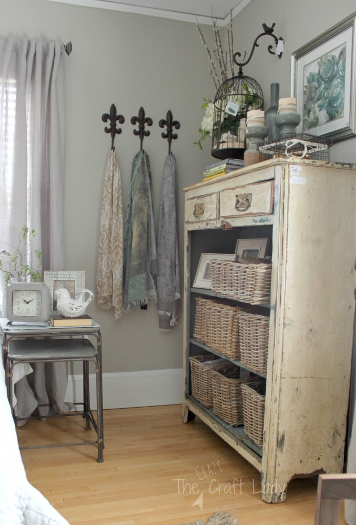 Spring bedroom makeover - Use an old dresser with wicker baskets for open shelving and extra bedroom storage. Genius!