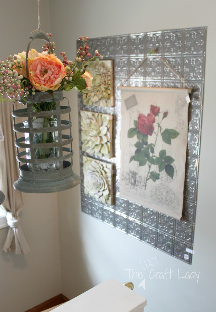 What a great idea!  Hang tine ceiling tiles on the wall, and swap out seasonal decor.  A great alternative to a gallery wall.  So much seasonal DIY decor inspiration!