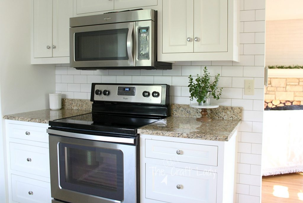 Make a White Subway Tile Temporary Backsplash with removable wallpaper. Follow this tutorial for a smooth, perfect finish. This temporary backsplash is the perfect option for anyone looking for a rental-friendly decor option or a home owner not ready to commit to tile and grout.