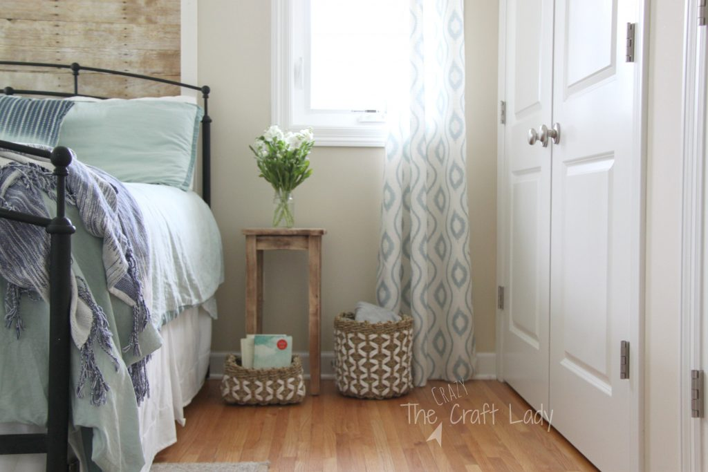 Coastal Bedroom with a Faux Plank Wall