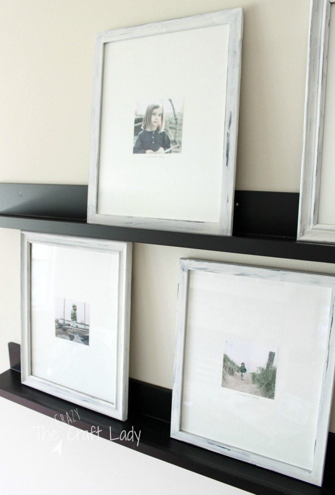 How to Paint and Distress Picture Frames - update inexpensive mismatched thrift store frames to make a beautiful and inexpensive gallery wall