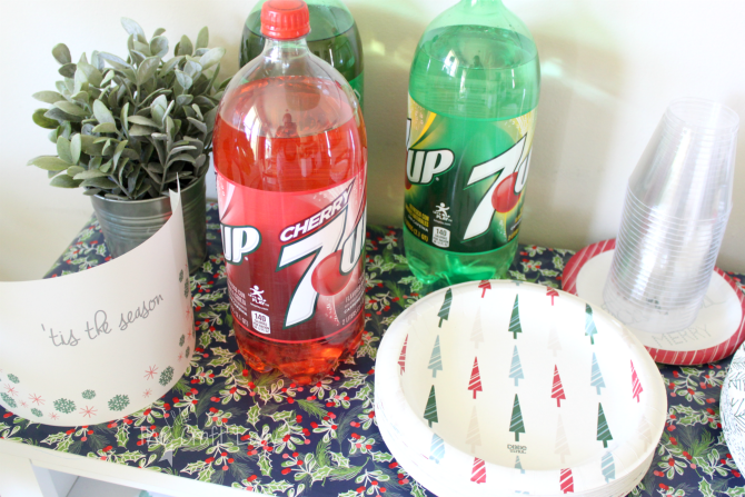 Easy Holiday Entertaining tip - use wrapping paper instead of a fabric tablecloth for easy clean up