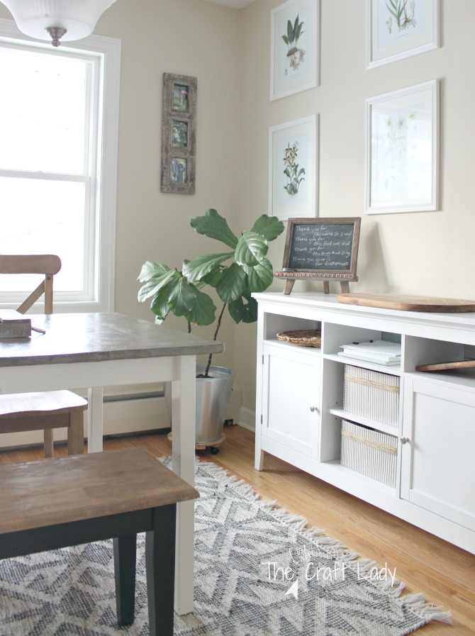 Casual Farmhouse Dining Room and DIY Concrete Table Top - Come see how my DIY Concrete Table Top has held up after 2 years of use. See what I would do differently, and take a peek at couple of small changes that I've made.