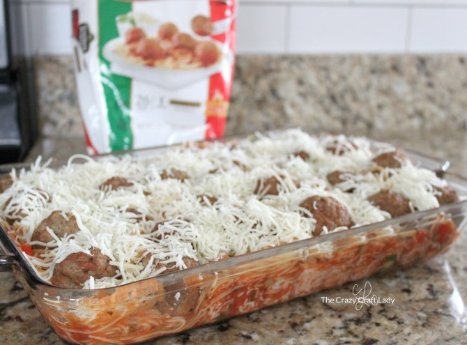 """Whip up a batch of this """"Hidden Veggie"""" Baked Spaghetti and Meatballs - a delicious and easy weeknight meal that the whole family will love. They won't even notice the extra vegetables in this tasty twist on a classic dish!"""