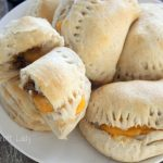 How to make Cheeseburger Pockets - These easy Cheeseburger pockets are a total crowd-pleaser. Use a tube of biscuit dough to whip up this weeknight meal in a snap.