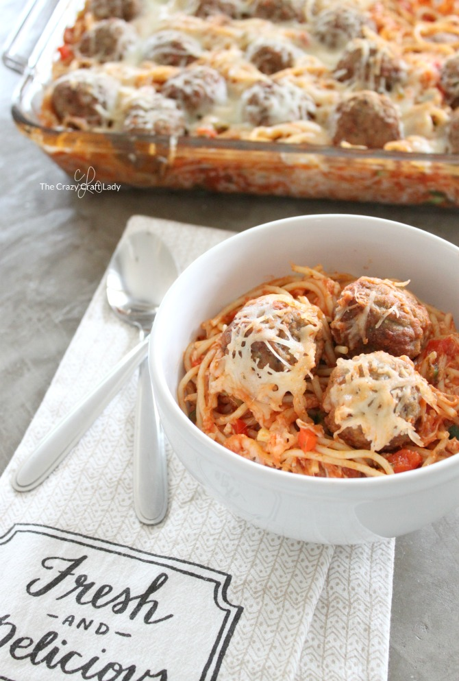 "Whip up a batch of this ""Hidden Veggie"" Baked Spaghetti and Meatballs - a delicious and easy weeknight meal that the whole family will love. They won't even notice the extra vegetables in this tasty twist on a classic dish!"