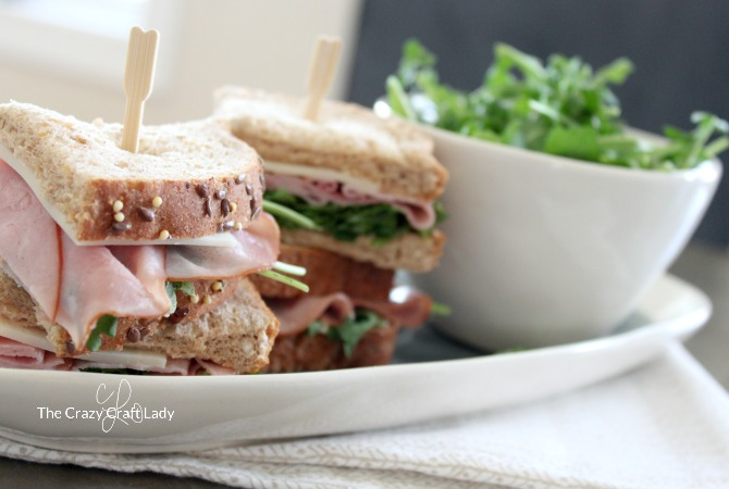Take the Six Ingredient Sandwich Challenge and whip up these tasty Spring Sandwich Stacks with ham, Swiss, arugula, and a GENIUS chipotle mayo recipe hack! Serve stacked sandwich squares on a toothpick for a fun presentation the whole family will love.