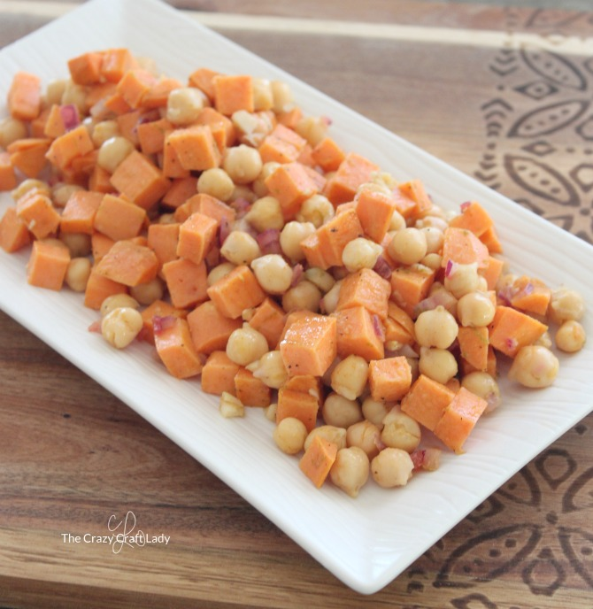 Serve this warm sweet potato and chickpea salad with a small lettuce salad for a fresh and filling lunch that is perfect as a weekend meal or in a weekday lunchbox.