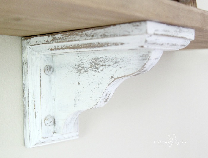 Save TONS of money and DIY these easy (saw and cutting-free) farmhouse kitchen shelves. No special skills required, just paint and stain!