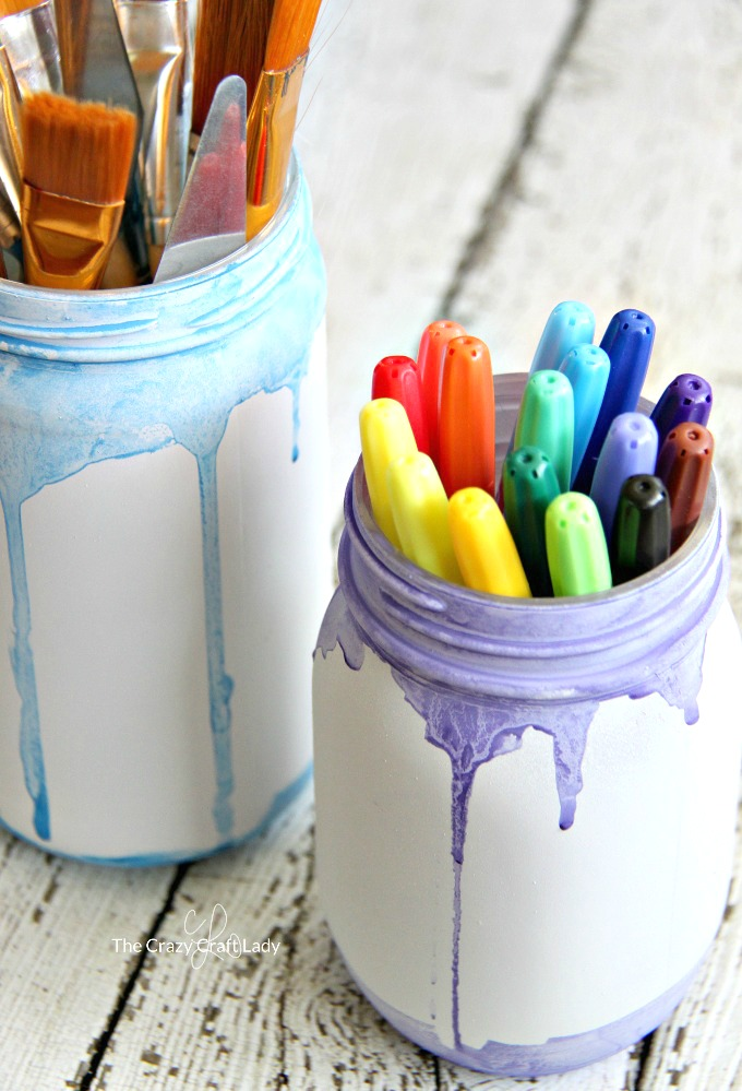 How cute are these simple painted watercolor jars? Painted mason jars are a fun and easy craft to make. Decorate them with watercolor paint for a custom vase or craft supply storage. I would love these in a painting studio!