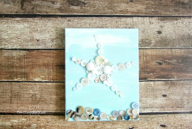 This little starfish craft is so cute! Learn how to make button art on canvas. This easy canvas craft made with old buttons is the perfect nautical addition to a gallery wall.