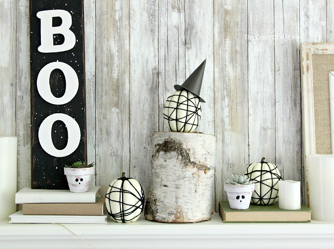 Follow a simple craft tutorial to make spider web pumpkins. This easy pumpkin decorating idea is perfect for mini pumpkins at Halloween. White pumpkins and black spider webs are perfect for neutral Halloween decor.