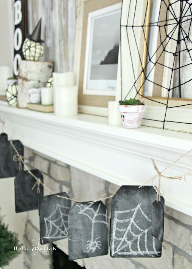 You'll LOVE these DIY indoor Halloween decorations and a neutral, farmhouse style Halloween mantel. Decorate your home for Halloween without being too spooky.