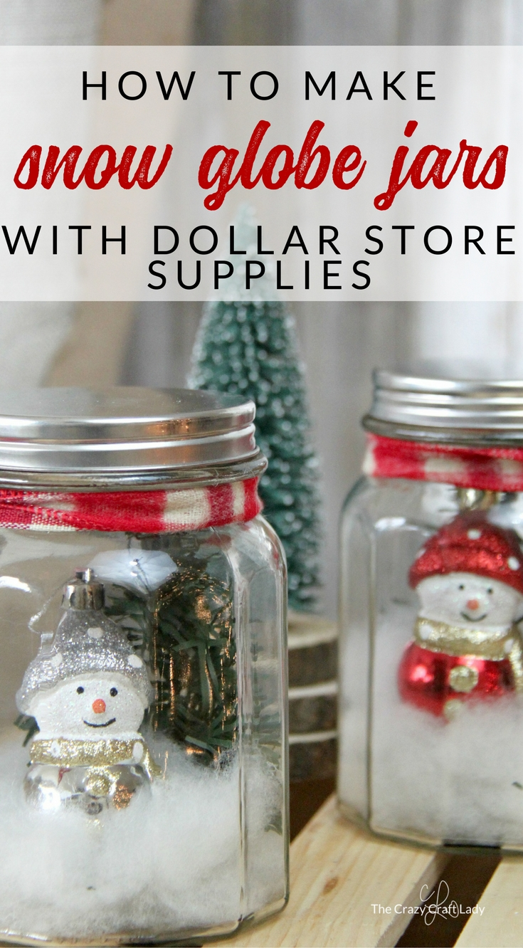 Use dollar store supplies to make a snowy winter scene in these DIY mason jar snow globes. Follow this simple tutorial and learn how to make a dollar store snow globe jar. Perfect winter craft - Christmas decor project.