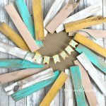 How to make a beautiful wood shim wreath. Paint inexpensive wood shims to make a fun and colorful wreath for spring.