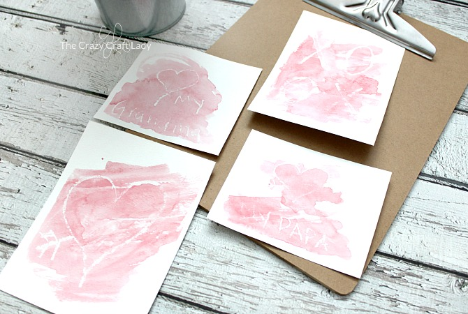 "These watercolor Valentine cards are a simple and fun Valentine's Day craft for both kids and adults. Paint over white paper, then watch your Valentine words and images ""magically"" appear!"