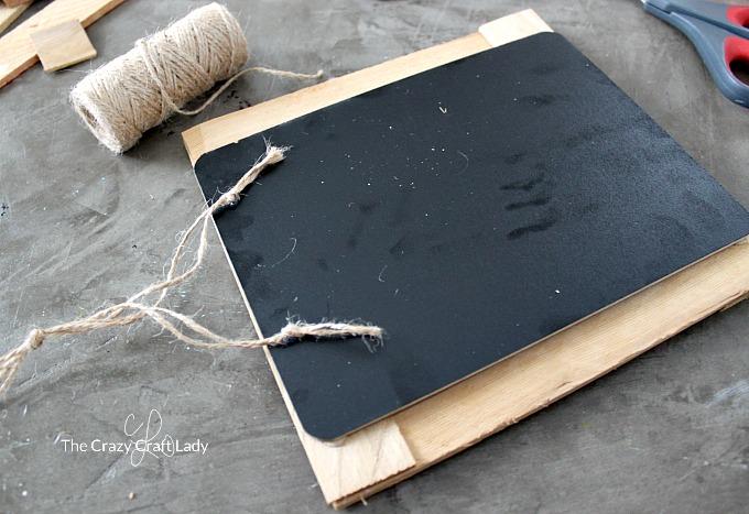 Adding twine to hand your DIY wood shim chalkboard frame
