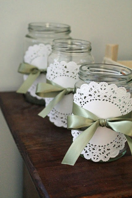 mason jars and paper doilies - tied with a simple satin ribbon