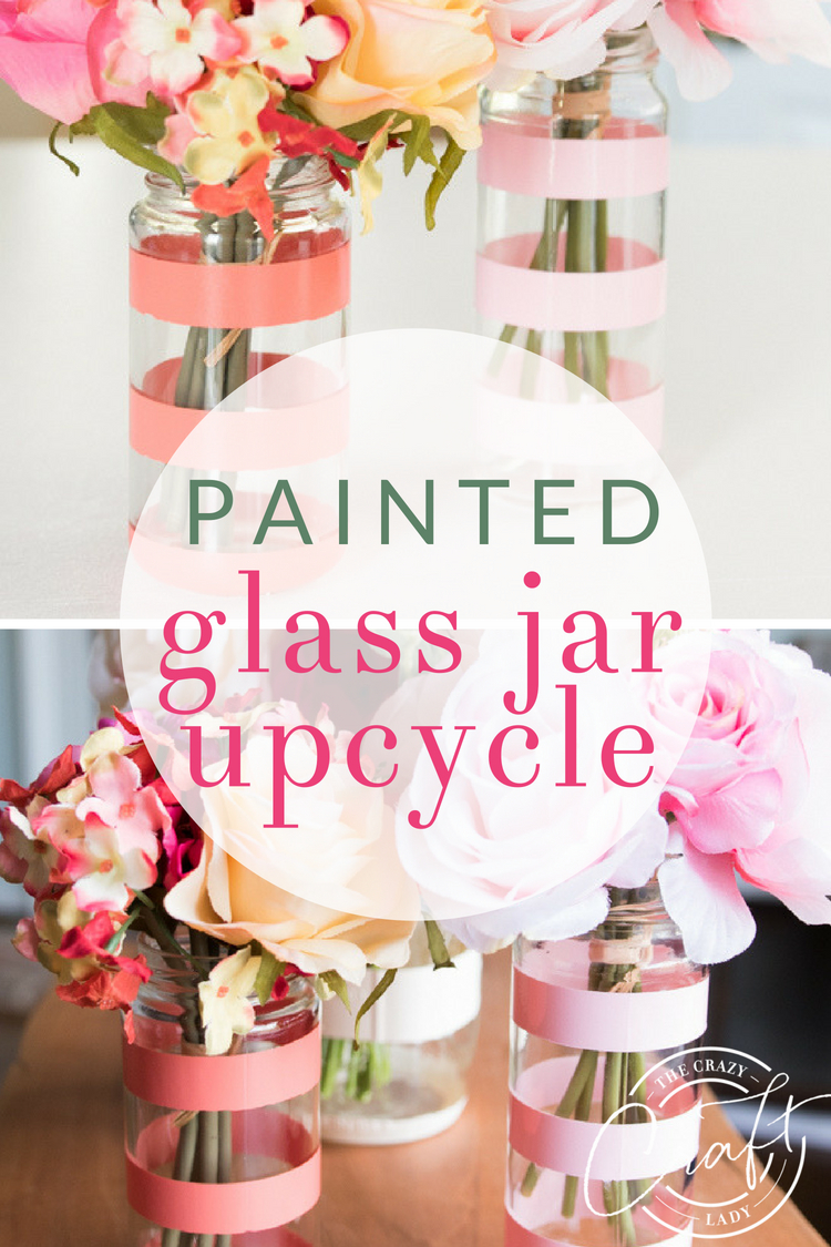 Create your own bud vases with a little spray paint and this glass bottle upcycle project. How to spray paint old glass jars to make spring flower vases.