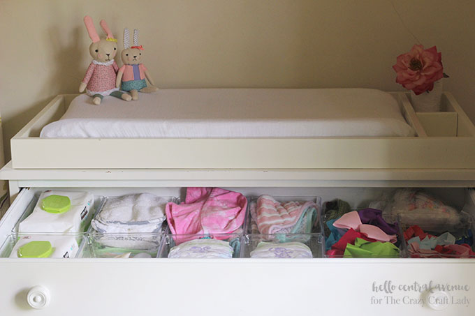 Organized changing table drawers with dollar store supplies