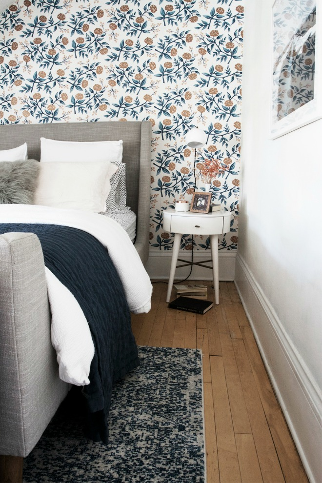 Bedroom Wallpaper Ideas - floral wallpaper with gray upholstered headboard