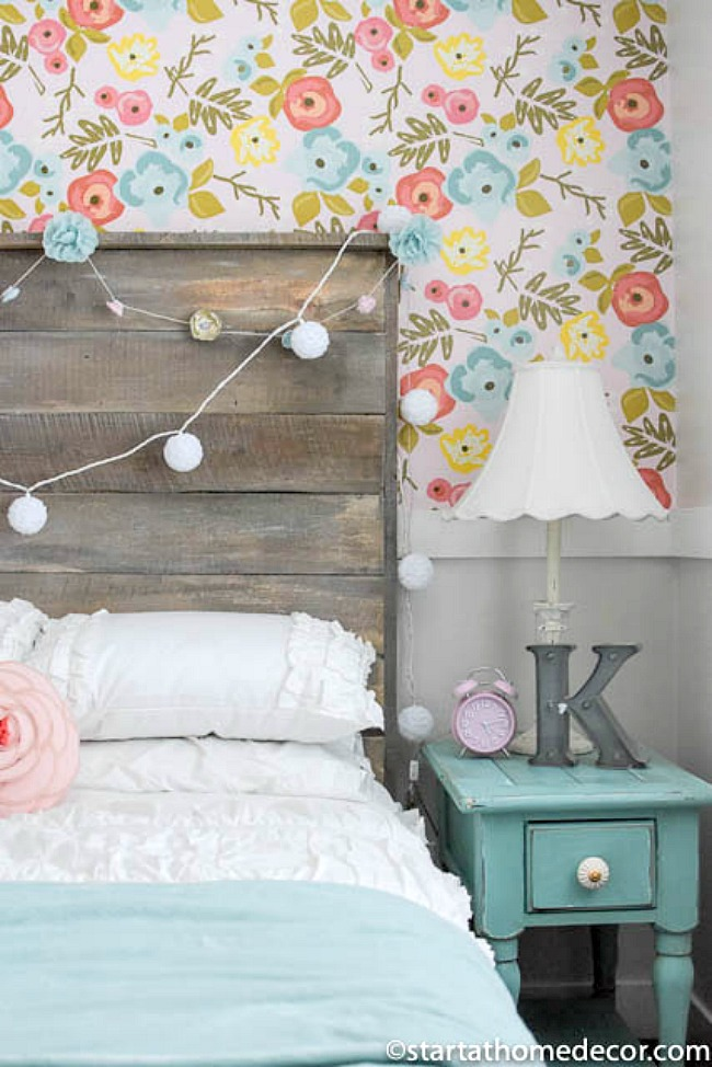 Bedroom Wallpaper Ideas - girls bedroom with reclaimed wood headboard and pastel floral wall