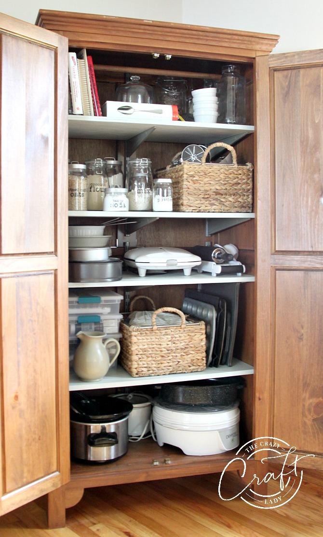 Organized Baking Supplies in an antique wardrobe