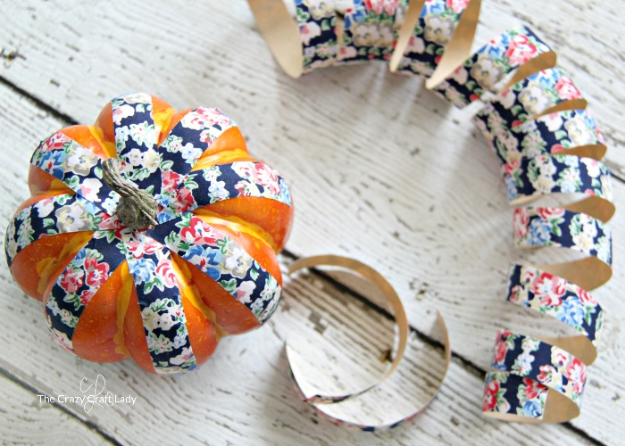 cover plastic pumpkins in fabric tape