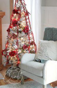 a 30 dollar walmart Christmas tree with dollar store ornaments.