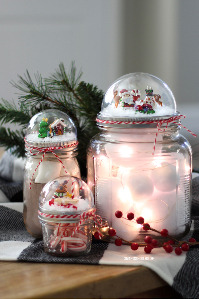 12 DIY Snow Globes filled with Winter Magic - mason jars and snow globe toppers