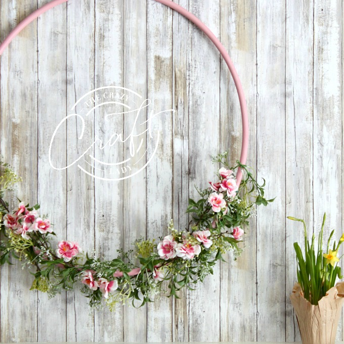 A cheery cherry blossom hula hoop wreath, perfect for spring decorating!