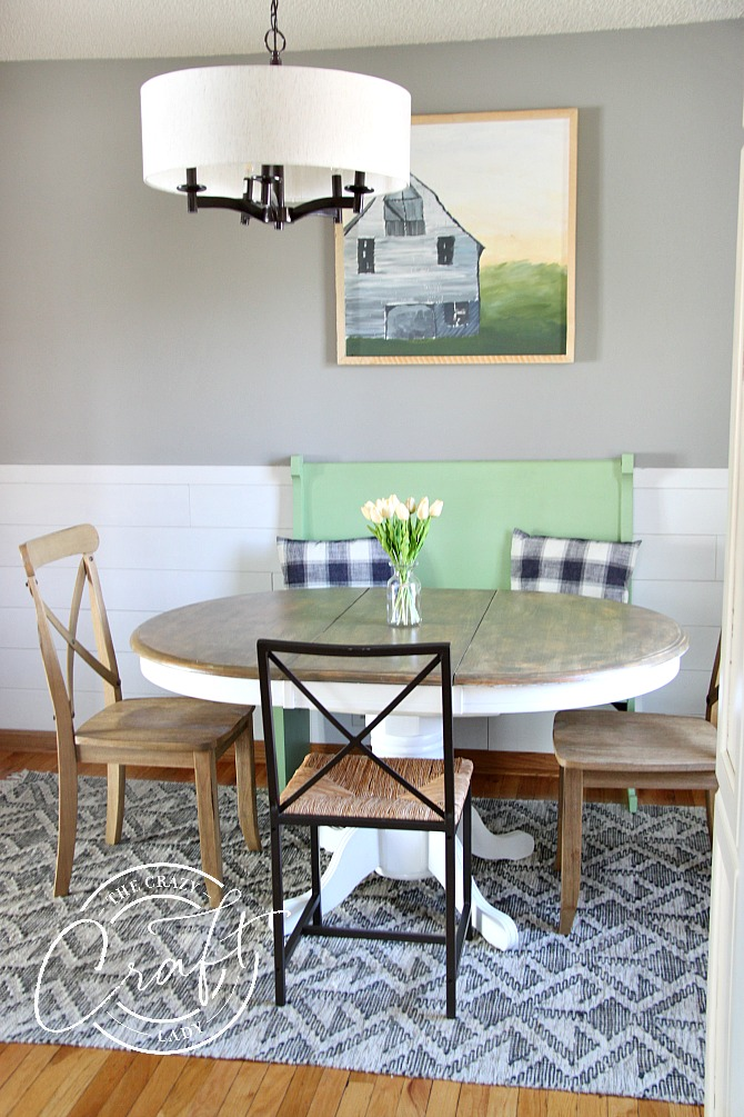 cottage farmhouse dining area with painted dining set and church bench seating