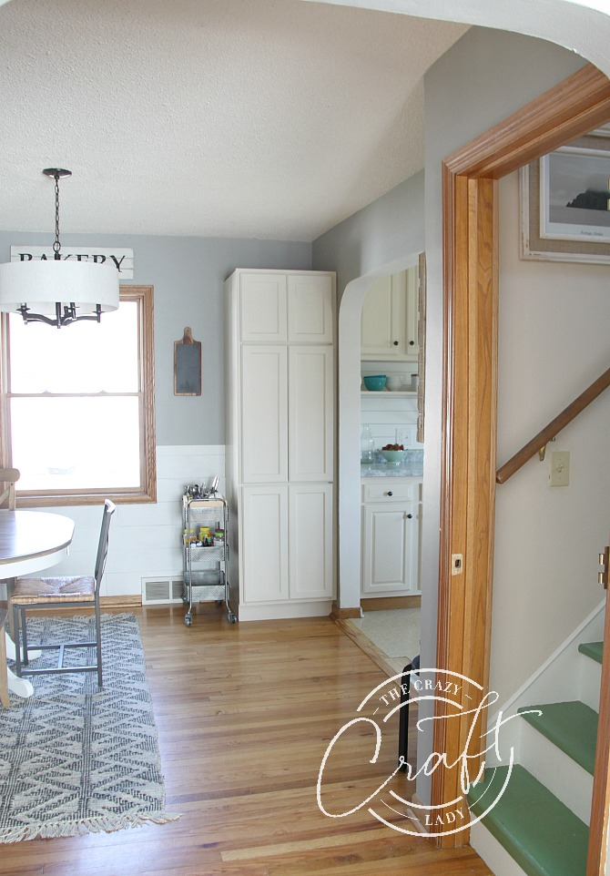 farmhouse dining room and painted green stairs