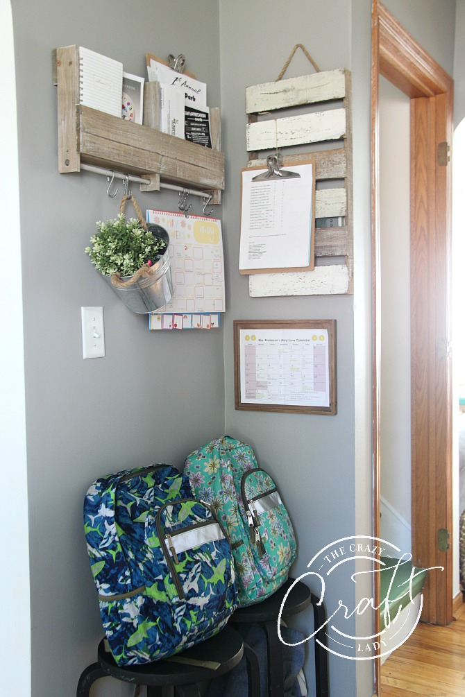organized family command center for school bags and calendars