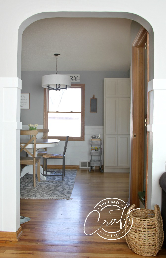 mixing board and batten with shiplap: view from living room into a neutral farmhouse dining room