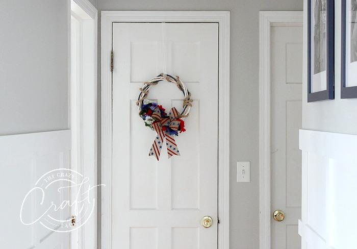 Patriotic wreath hanging in a hallway