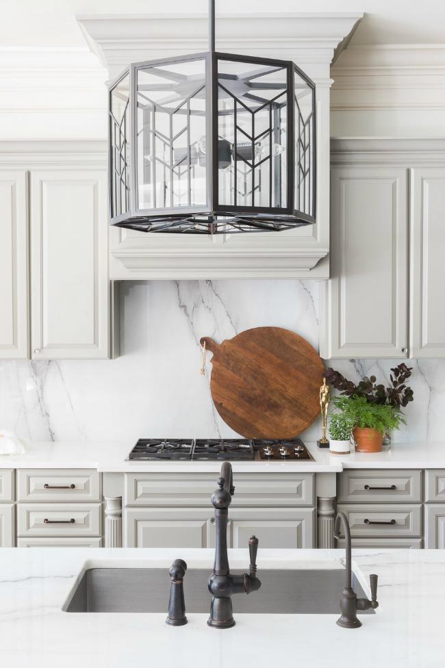 Sherwin Williams Dorian Gray Cabinets in a bright neutral kitchen