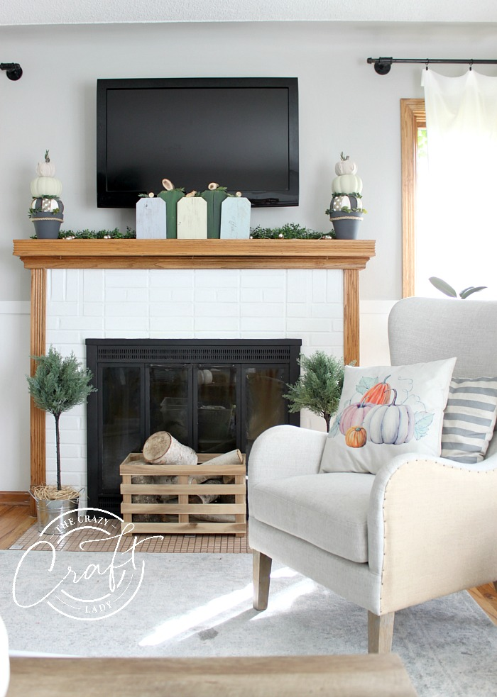 Neutral farmhouse style fall living room and mantel