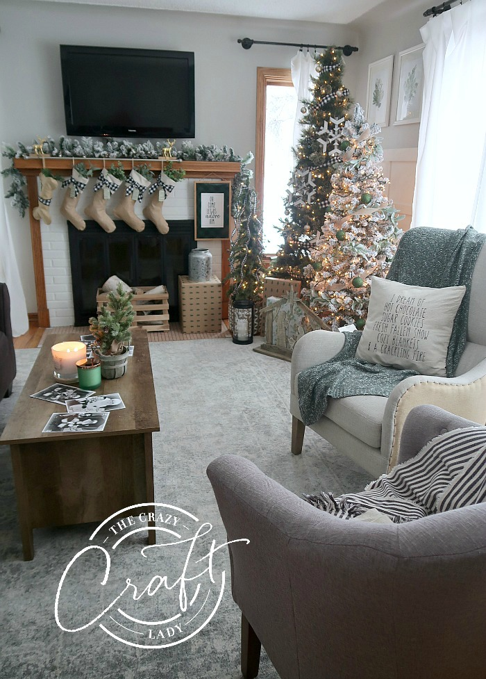 Farmhouse Christmas living room tour with neutral Christmas decorations in muted blues, greens, buffalo check, burlap and galvanized metal.